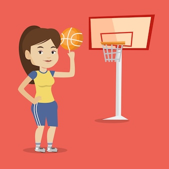 De jonge spinnende bal van de basketbalspeler.