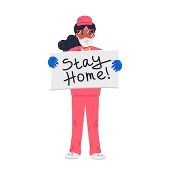 De jonge verpleegster in roze schrobt holdingsteken met de inschrijving van het verblijfshuis