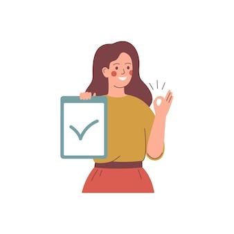 De jonge vrouw houdt een aanplakbiljet met keurmerk en steekt haar hand met teken ok op.