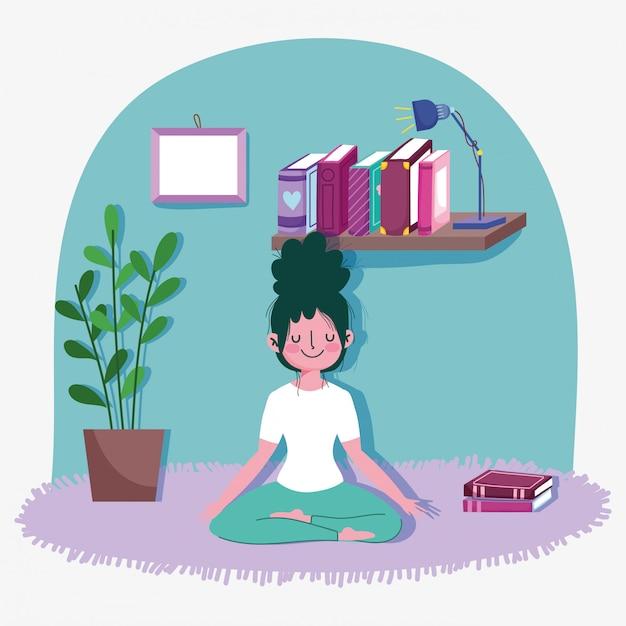 De jonge vrouw in lotusbloem stelt thuis de sportoefening van de yogaactiviteit