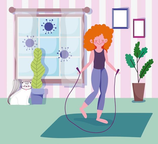 De jonge vrouw met touwtjespringen in ruimte met venster, oefent sportoefening thuis covid pandemie 19