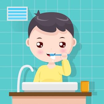 De jongen die tanden poetst