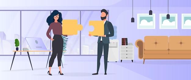 De jongen en het meisje houden puzzelstukjes vast. de vrouw en de man leggen een puzzel in elkaar. kantoor. het concept van teamwork, samenleven of begrip. vector.