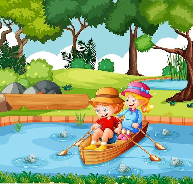 De jongen en het meisje roeien de boot in het park