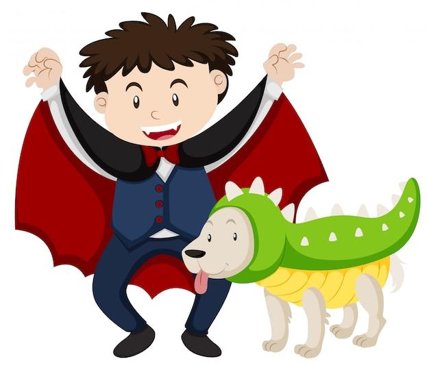 De jongen kleedde zich als vampier en hond als dinosaurus