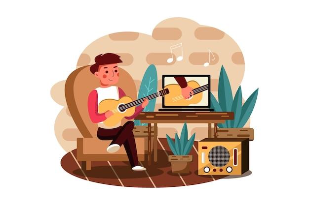 De jongen leert volgens een online tutorial muziekinstrument bespelen.