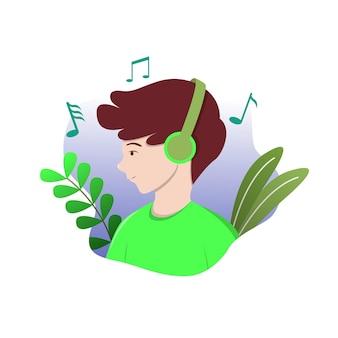 De jongen luistert naar de muziek met zijn koptelefoon