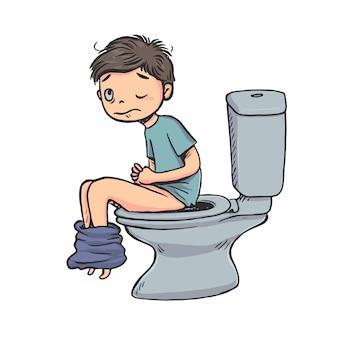 De jongen zit 's ochtends op het toilet