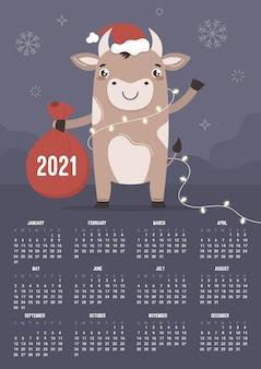 De kalender. chinees symbool stier os houdt een zak met geschenken. gelukkig nieuwjaar en vrolijk kerstfeest.