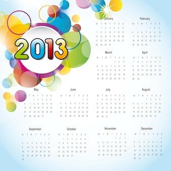 De kalender van 2013 met kleurrijke cirkelsachtergrond