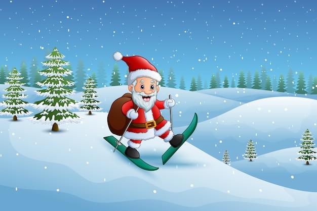 De kerstman die in de sneeuwheuvel skiô