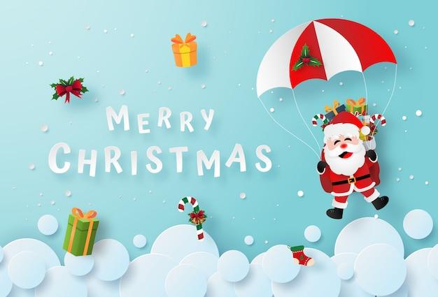 De kerstman maakt een parachutesprong in de lucht