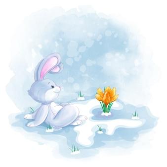 De kleine haas zit en kijkt naar de tot bloei gekomen lentebloem. aquarel textuur
