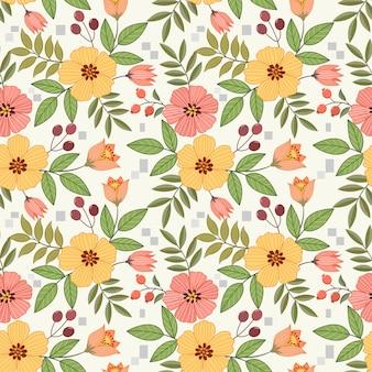 De kleurrijke hand trekt bloemen naadloos patroon voor stoffen textielbehang.