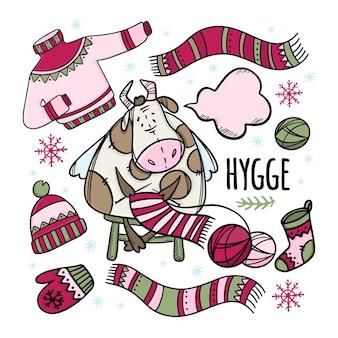 De koe van kerstmis breit winterkleren