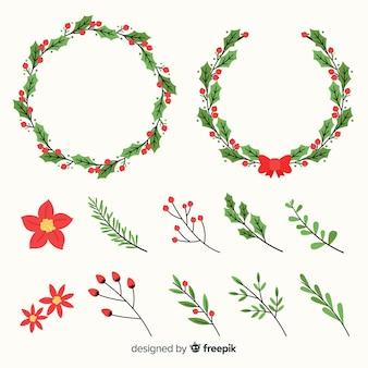 De kroon van kerstmis met winter bloemen instellen