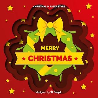 De kroonornament van kerstmis met lintachtergrond