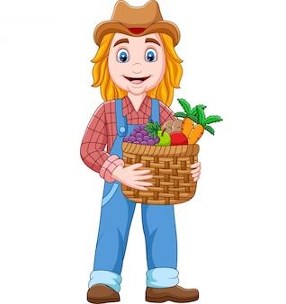 De landbouwer die van het beeldverhaalmeisje een mand van groente en vruchten houdt
