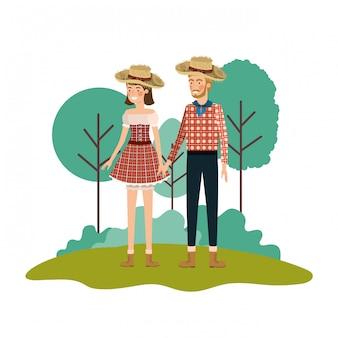 De landbouwers koppelen het spreken met strohoed in landschap