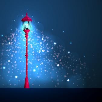 De lantaarn schijnt met harten op donkerblauw. fijne valentijnsdag.