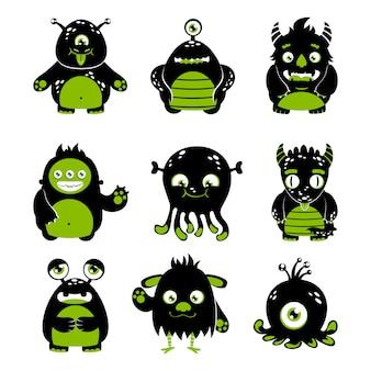 De leuke zwarte en groene reeks geïsoleerde vectorillustratie van beeldverhaalmonsters grappige vreemde karakter