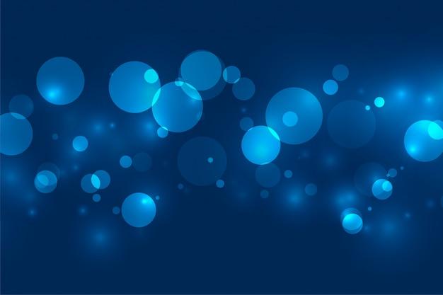 De magische blauwe bokehflikkering steekt achtergrond aan