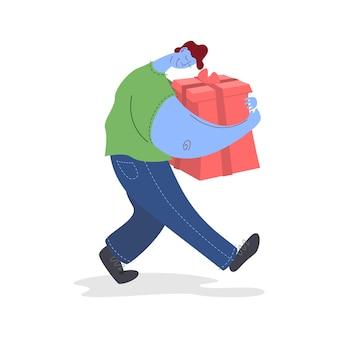 De man draagt een cadeautje in een rode doos