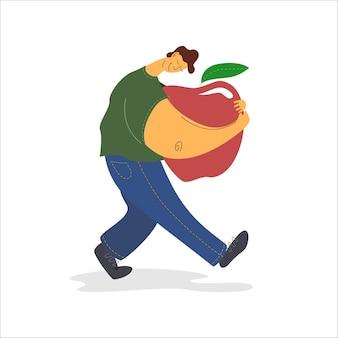 De man draagt een grote appel