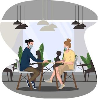 De man en de vrouw eten samen in restaurant tijdens nieuw normaal