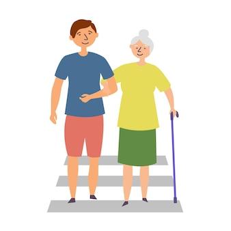 De man helpt de oma met een handicap de weg oversteken