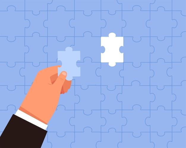 De man legt het laatste detail in de puzzel. bedrijfsconcept van succes en voltooiing van zaken. cartoon plat. geïsoleerd op een witte achtergrond.