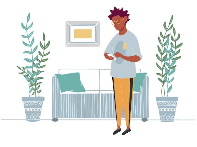 De man met de telefoon staat op de achtergrond van het interieur, meubels in een vlakke stijl. een man kijkt naar de telefoon. illustratie.