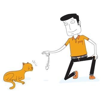 De mens geeft een vis aan een hongerige kat