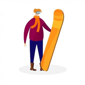 De mens in de winterkleding en glazen houdt snowboard.