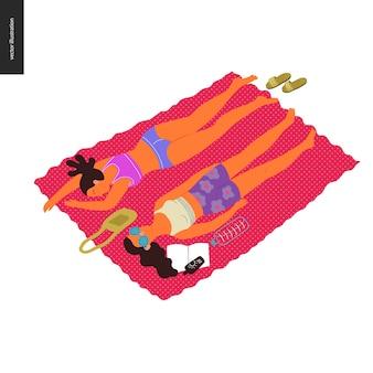 De mensen parkeren festivalpicknick - twee donkerbruine vrouwen die op de deken in park leggen, zon vangen, zonnebaden
