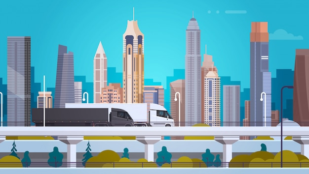 De moderne achtergrond van het stadslandschap met semi vrachtwagenaanhangwagensvoertuigen op wegweg