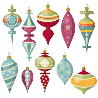 De mooie inzameling van kerstmisballen die op wit wordt geïsoleerd