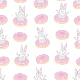 De naadloze leuke vectorillustratie van het konijntjespatroon