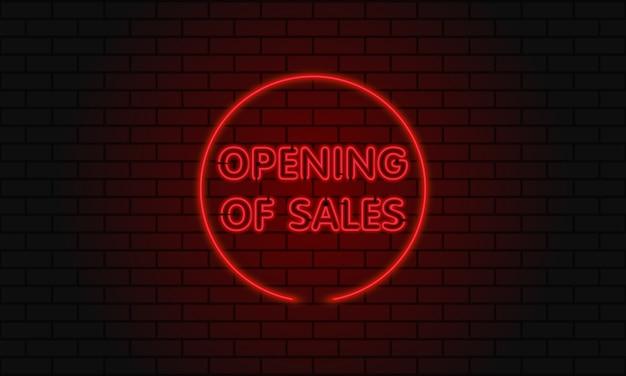 De open verkoop van het neonteken in een cirkel op bakstenen muurachtergrond.