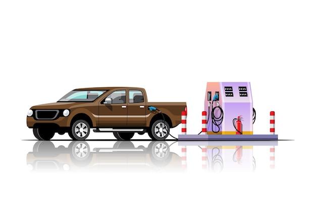 De pick-up auto tankt bij de afbeelding van het tankstation