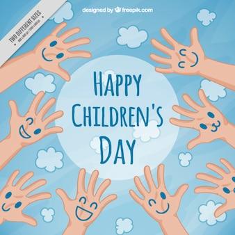 De plezierige kinderen dag achtergrond met gezichten geschilderde handen