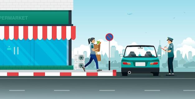 De politie schrijft verkeersopdrachten voor auto's die in verboden gebieden geparkeerd staan.