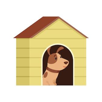 De puppy zit in een hondenhok.