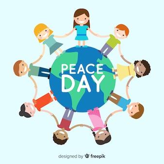De samenstelling van de vredesdag met kinderen die handen rond de wereld houden