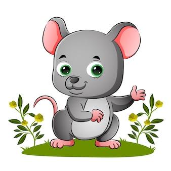 De schattige muis gebaart met de hand in de illustratietuin