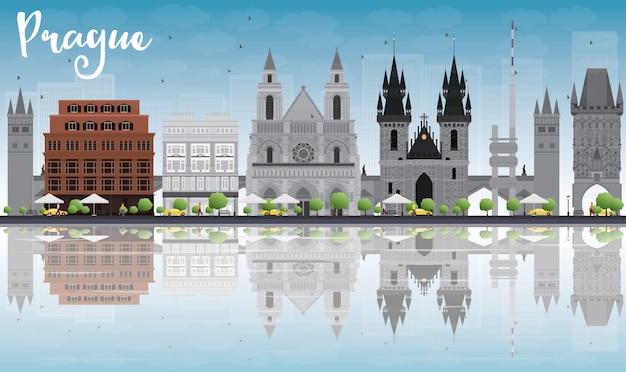 De skyline van praag met grijze monumenten, blauwe lucht en reflecties