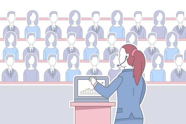 De spreker van het meisje in hoofdtelefoon met laptop geeft een toespraak aan het publiek