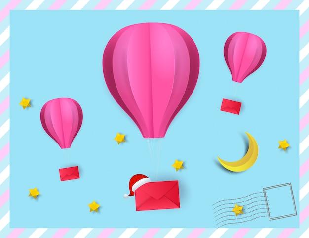 De stijl van de document kunst van roze kleur van de hete luchtballon hangt rode envelop die op de hemel drijft. poste