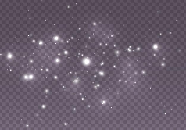 De stofvonken en gouden sterren schijnen met speciaal licht. lichteffect. sneeuw. . abstract. magisch concept. abstracte achtergrond met bokeh effect.