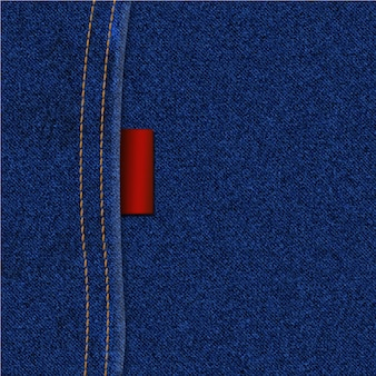 De textuurachtergrond van jeans met naad en etiket